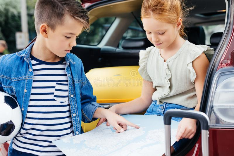 adorable little kids with map royalty free stock image