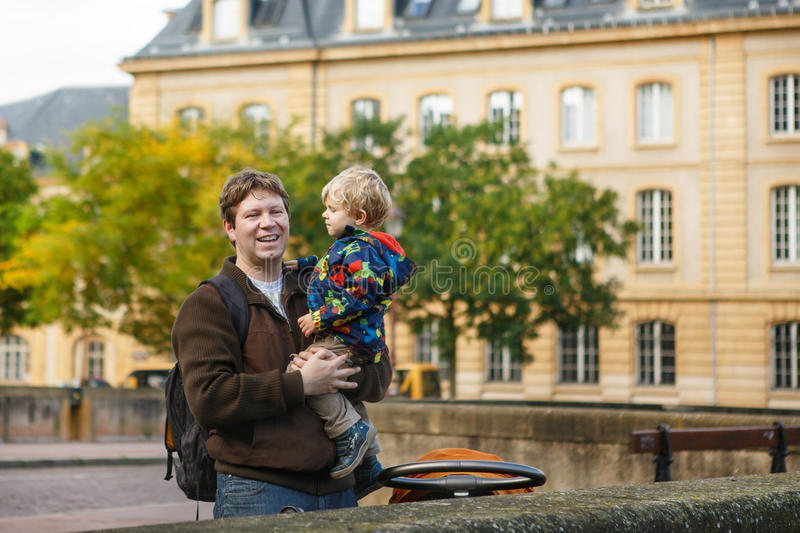 Adorable Little Son And Father In Autumn City. Royalty Free Stock Photo