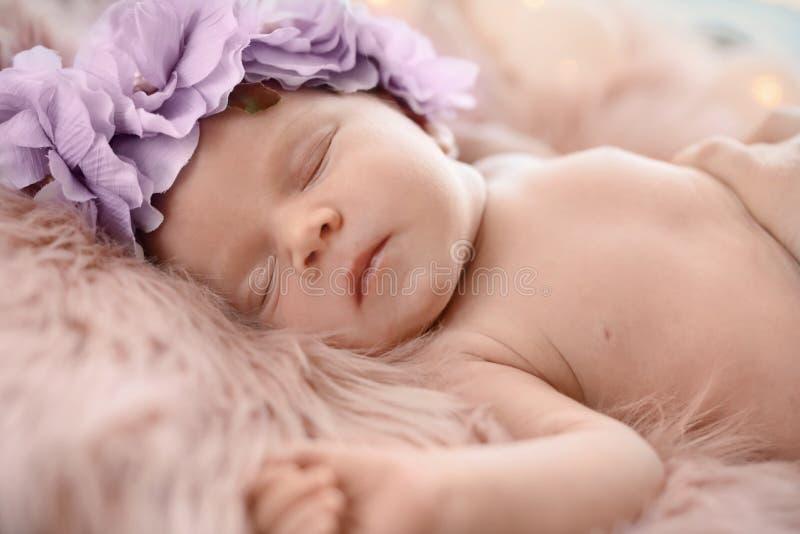 Adorable newborn baby girl with floral headband sleeping royalty free stock photos