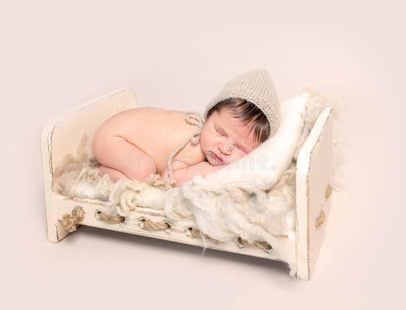 Adorable newborn baby sleeping on his stomach royalty free stock images