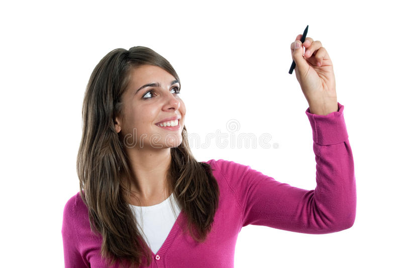 Adorable pretty girl writing. Isolated on a over white background stock photography