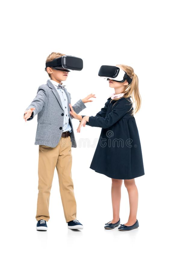 Pupils in VR headsets. Adorable pupils in VR headsets isolated on white stock photos