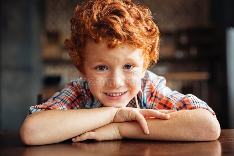 Adorable redhead boy smiling into camera stock photos