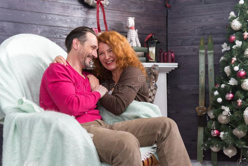 Adorable romantic couple putting heads together and smiling royalty free stock photography