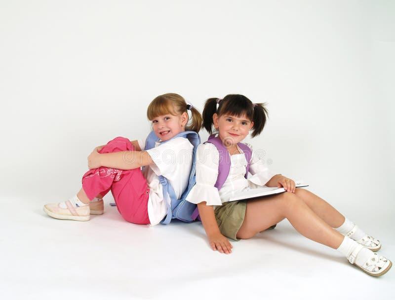 Adorable school girls stock image