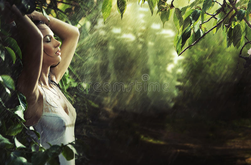 Adorable brunette in a rain forest royalty free stock images