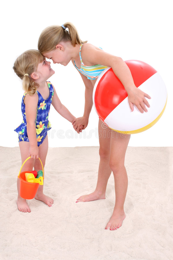 Download Adorable Sisters Playing In The Sand Stock Photo - Image of friend, attractive: 158458