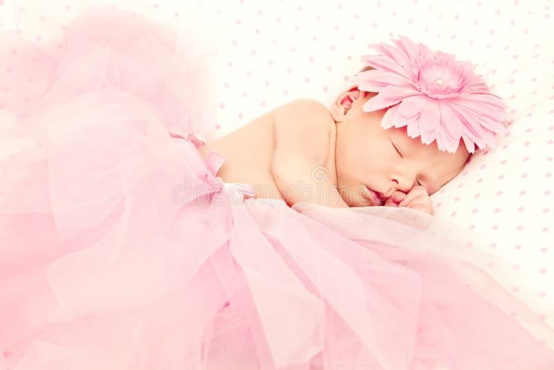Adorable sleeping newborn baby girl royalty free stock images