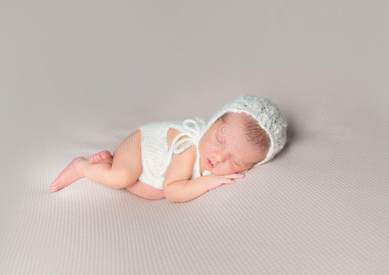 An adorable sleeping newborn baby girl stock photos
