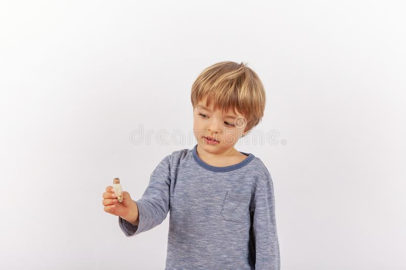 Adorable small boy showing a hearing aid royalty free stock photos