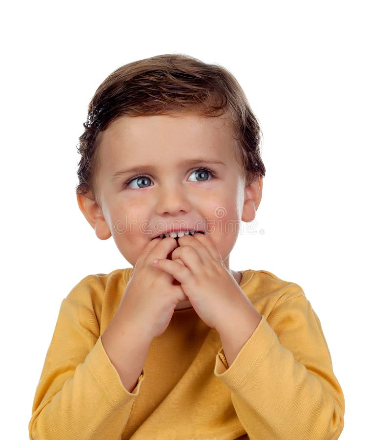 Adorable small child two years old sucking his hand isolated on stock photo