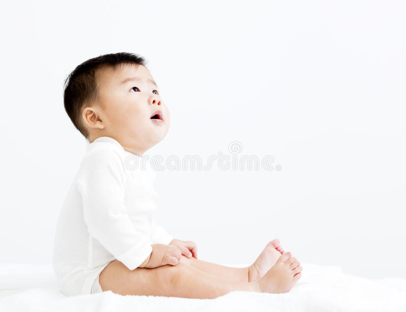 Adorable smiling baby boy looking up royalty free stock photo