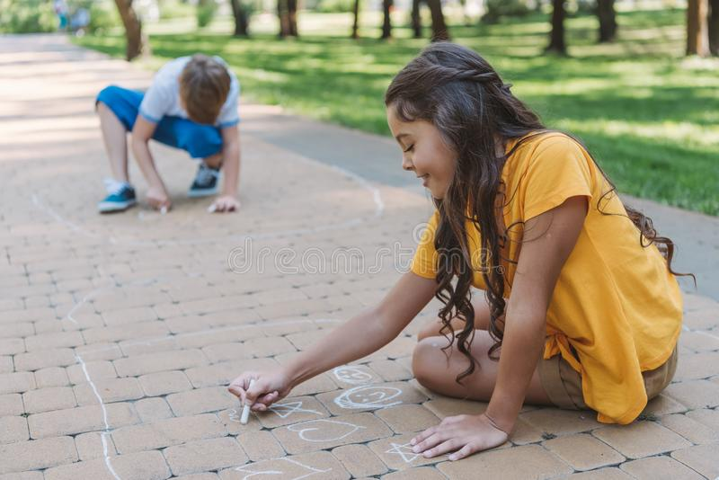 adorable smiling children drawing with chalk royalty free illustration
