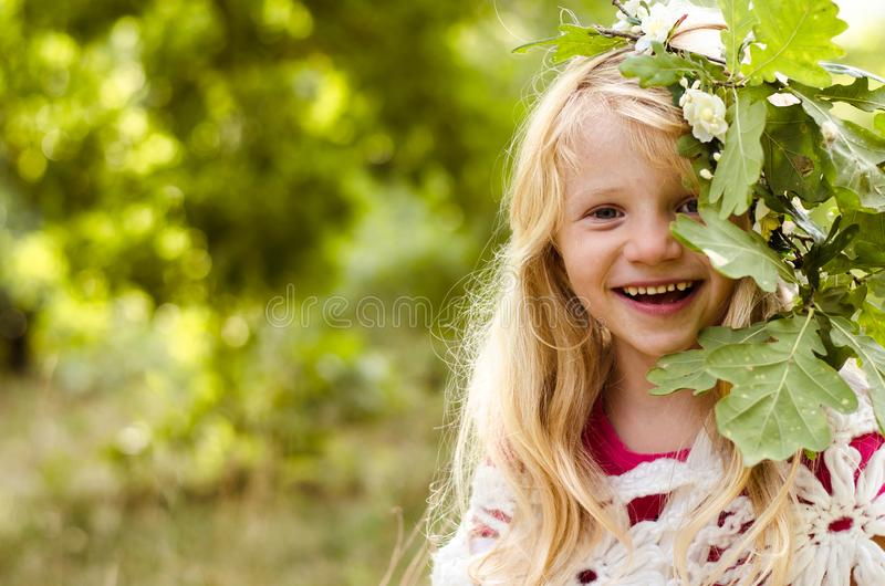 Adorable smiling girl with long blond hair royalty free stock photo