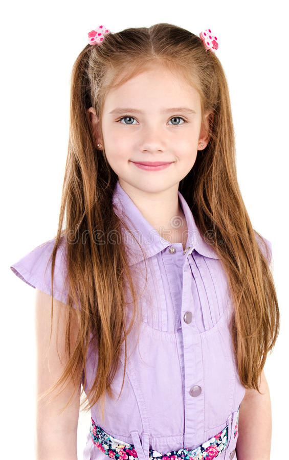 Adorable smiling little girl in dress isolated stock image