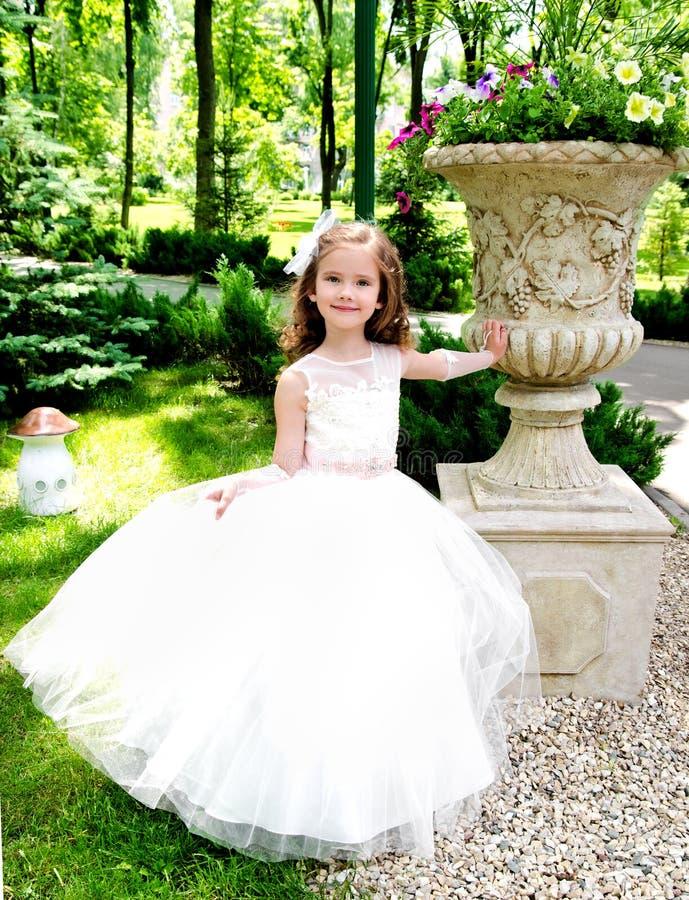 Adorable smiling little girl in princess dress stock photos