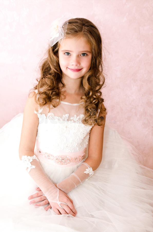 Adorable smiling little girl in white princess dress. Isolated stock photos