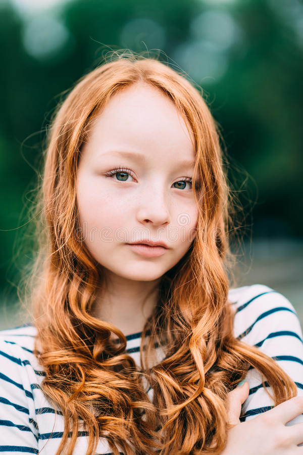 young girl with red hair stock photo image of forest an adorable smiling young woman with green eyes and curly
