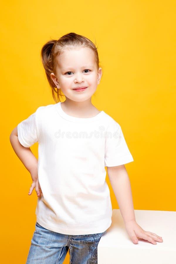 Adorable stylish girl posing on yellow background stock photos
