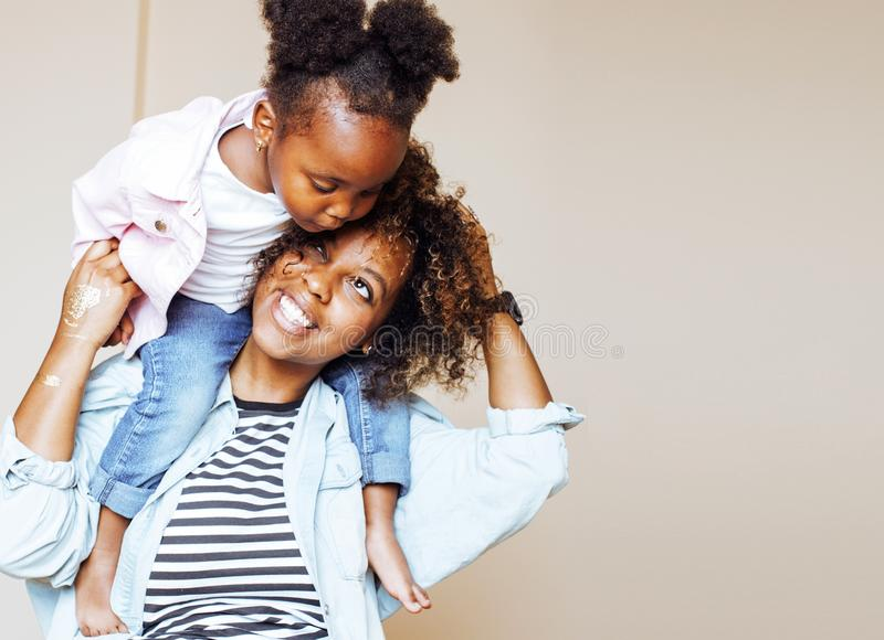adorable sweet young afro-american mother with cute little daugh stock images