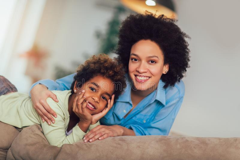 Sweet young afro-american mother with cute little daughter stock image