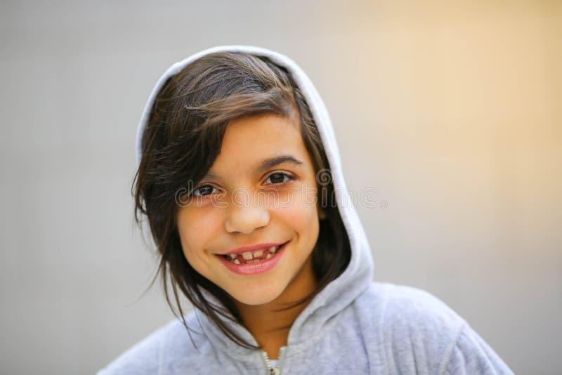 Adorable teen girl portrait in hoodie stock image