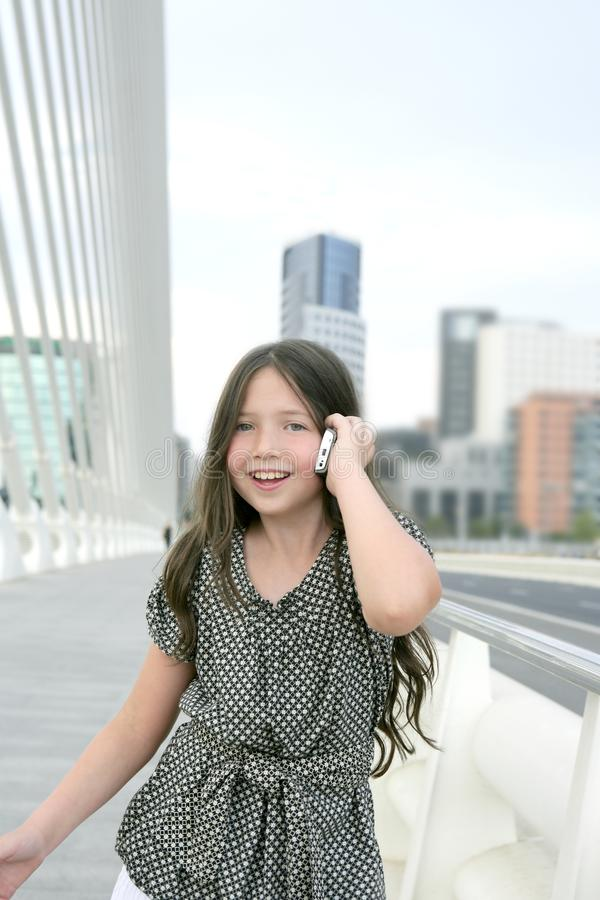 Adorable teenager little girl talking phone stock images