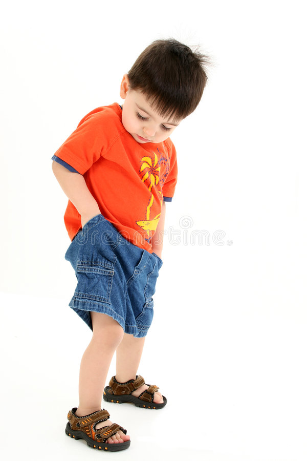 Download Adorable Toddler Boy Checking Pockets For Money Stock Image - Image: 191471