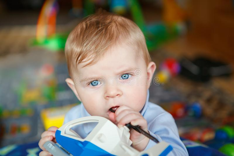 Adorable toddler boy having fun stock photo