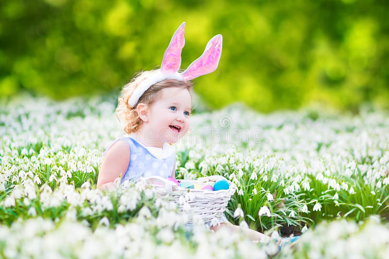 Adorable toddler girl in bunny ears with Easter egg royalty free stock photos