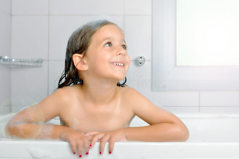 Real Adorable Toddler Girl Relaxing In Bathtub