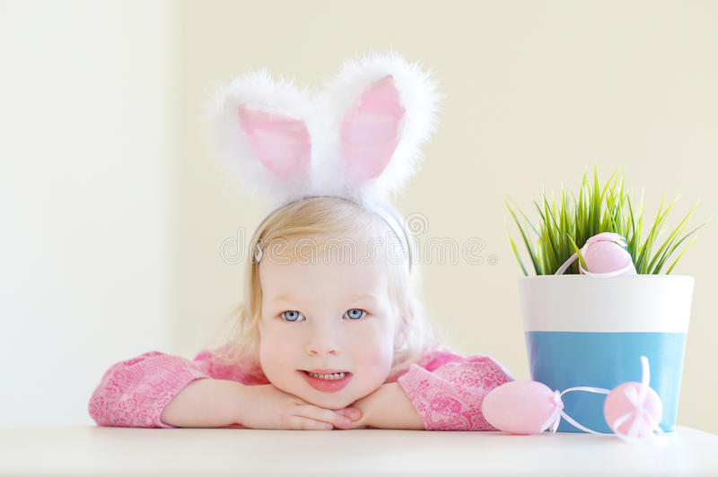 Adorable toddler girl wearing bunny ears on Easter. Day royalty free stock photo