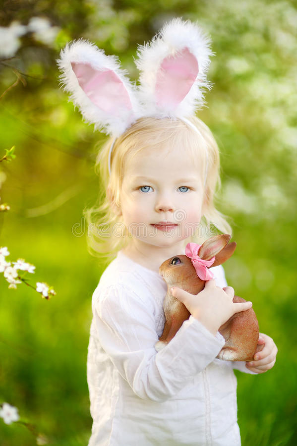 Adorable toddler girl wearing bunny ears on Easter stock photography