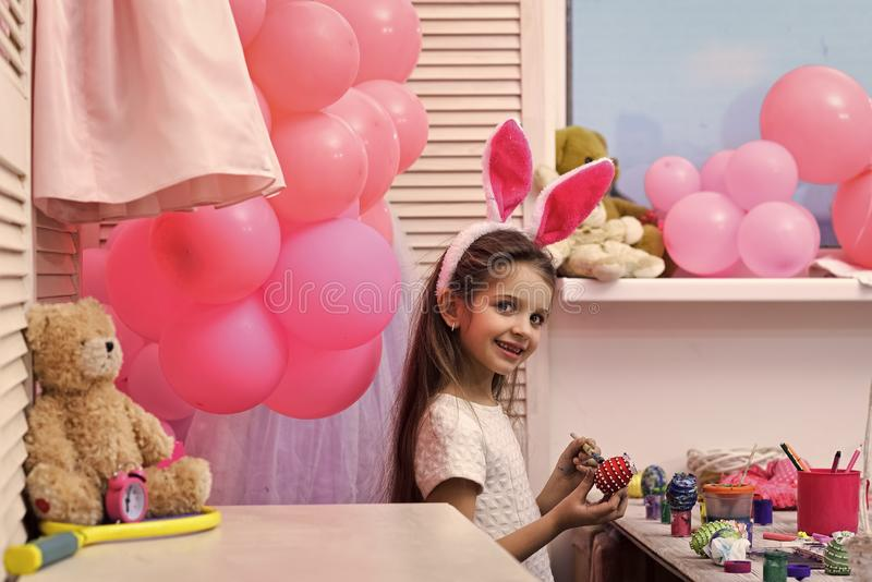 Adorable toddler girl playing with Easter eggs stock photography