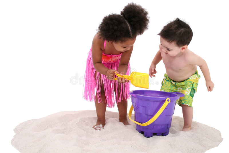 Adorable Toddlers Playing In The Sand stock photography
