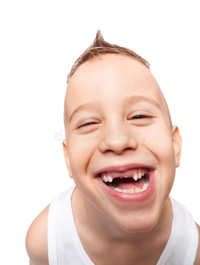 Adorable toothless smile. Boy with adorable toothless smile on isolated white using wide angle lens stock photos