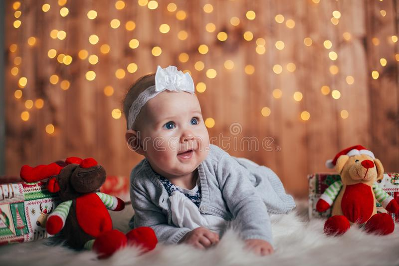 Adorable two month old baby girl lying on the pillow royalty free stock photo