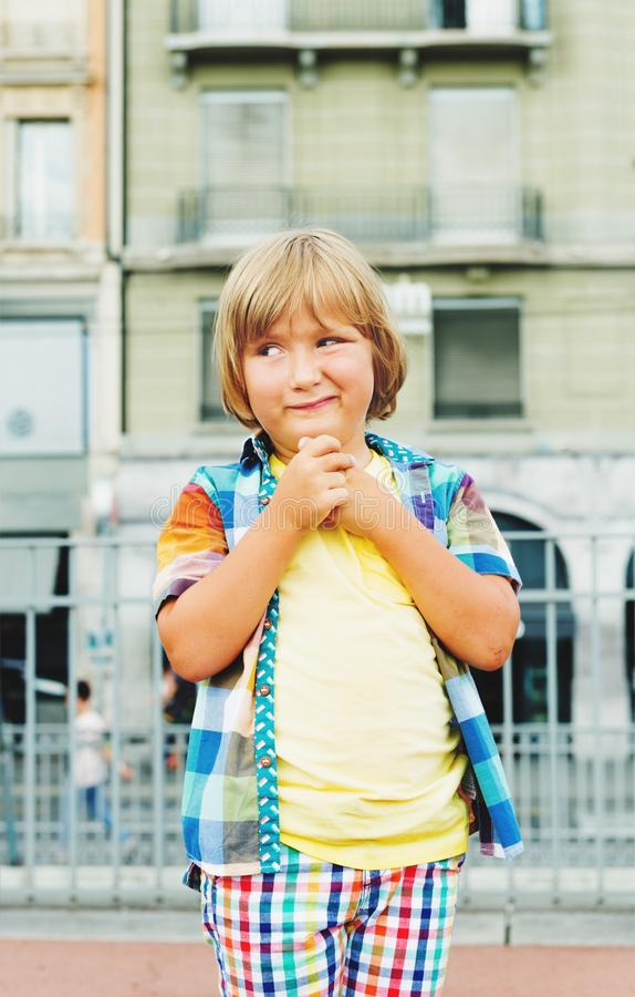 Little boy portrait. Adorable 5 year old preschooler boy with funny facial expression royalty free stock image