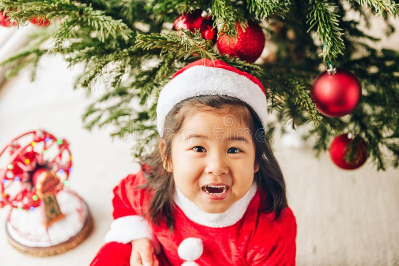 Adorable 3 year old toddler girl enjoying Christmas time stock images