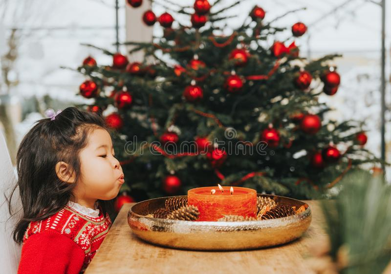 Adorable 3 year old toddler girl enjoying Christmas time royalty free stock photos
