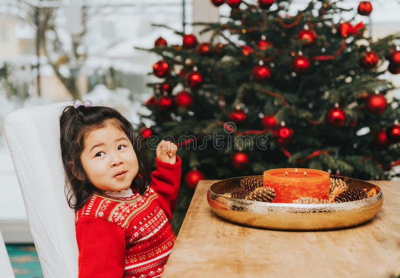 Adorable 3 year old toddler girl enjoying Christmas time stock photos