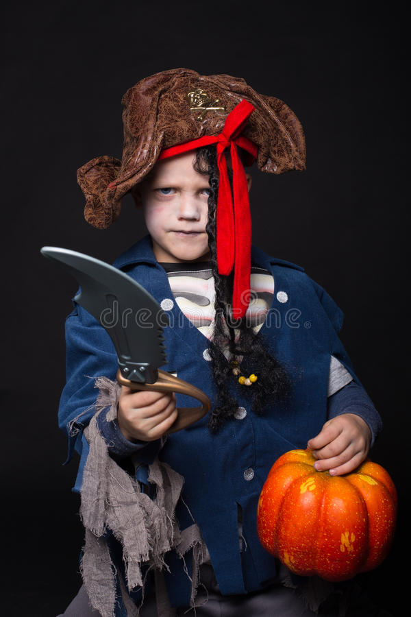 Adorable young boy dressed in a pirate outfit, playing trick or treat for Halloween stock images