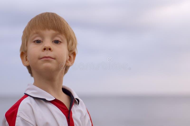 Adorable Young Boy Looking At Camera Stock Photography