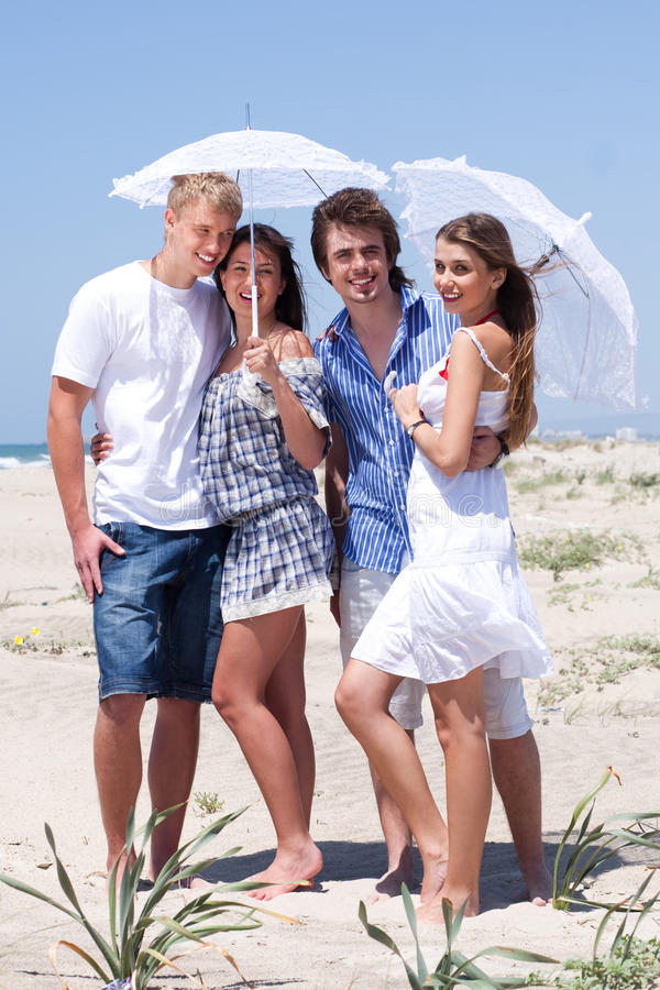 Free Adorable Young Couples Under An Umbrella Royalty Free Stock Photo - 16027025