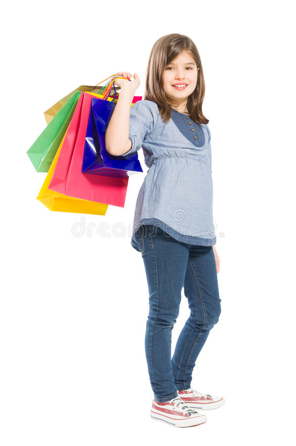 Adorable, young and cute shopping girl royalty free stock images