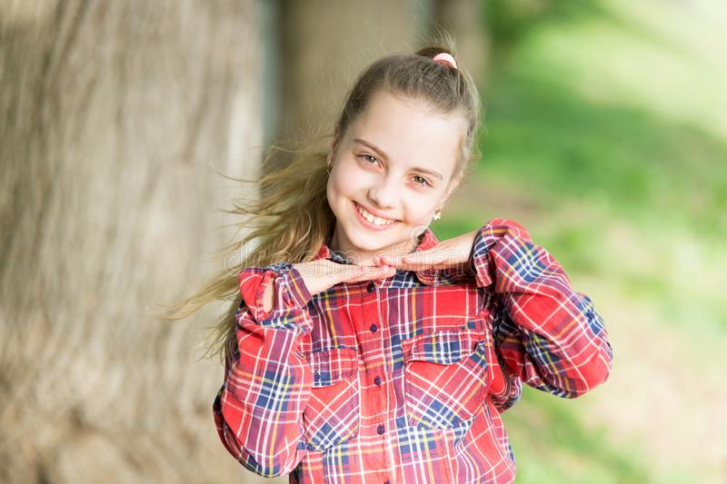 Adorbale baby face. Happy kid with cute face look. Small girl smiling with healthy young face skin and long blond hair stock image