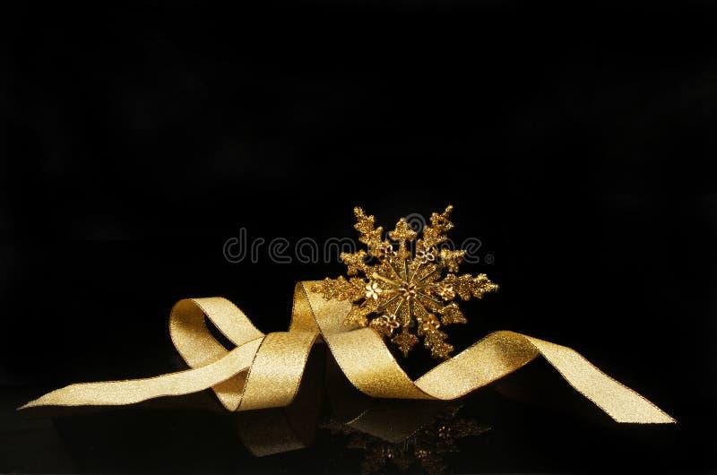 Adorno de la Navidad de la cinta y de la estrella foto de archivo libre de regalías