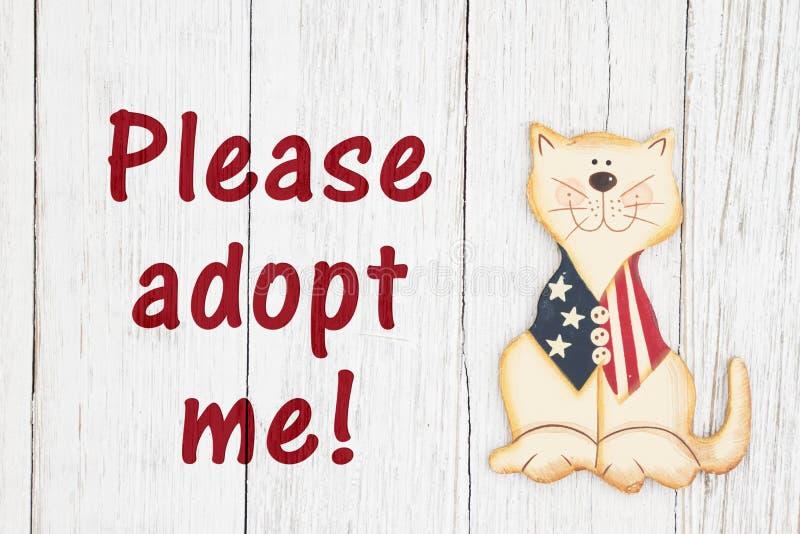 Adote-me por favor texto com o gato patriótico americano fotografia de stock