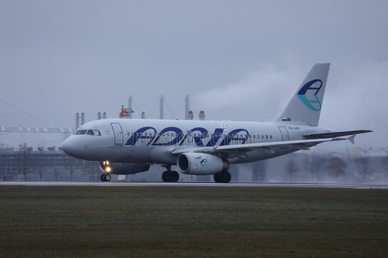 Adria Airways plane taxiing on runway, Munich Airport, MUC. Adria Airways jet takes off from runway royalty free stock photography