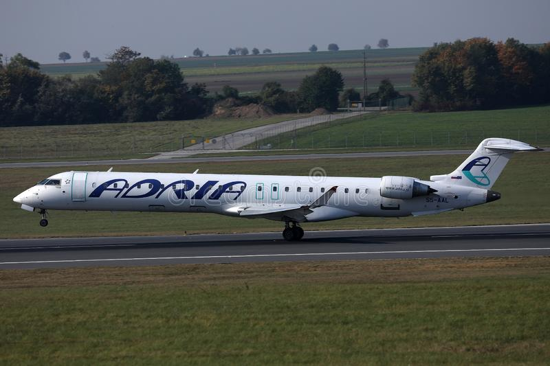 Adria Airways taking off from runway, Vienna Airport, VIE. Adria Airways jet takes off from runway stock image